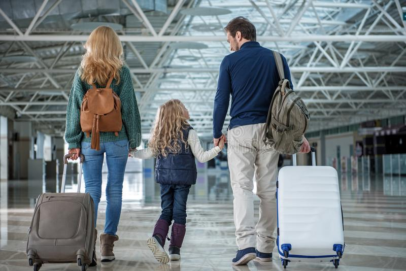 Happy family arriving at the destination stock photos