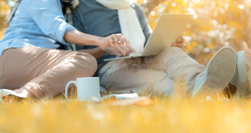 Happy family asian senior couple retirement using laptop computer searching anything stock photos