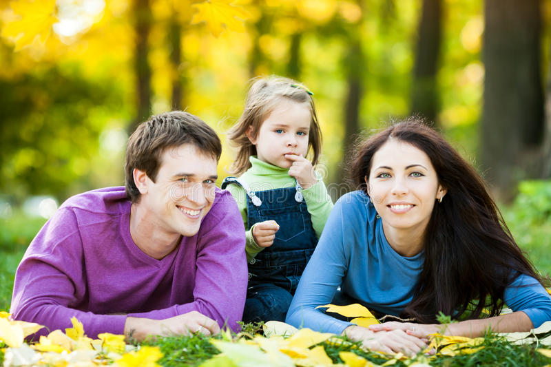 Download Happy family in autumn stock image. Image of leaves, holding - 25160565