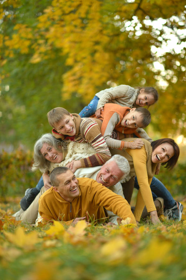 Happy family in autumn forest. Happy smiling family relaxing in autumn forest stock image