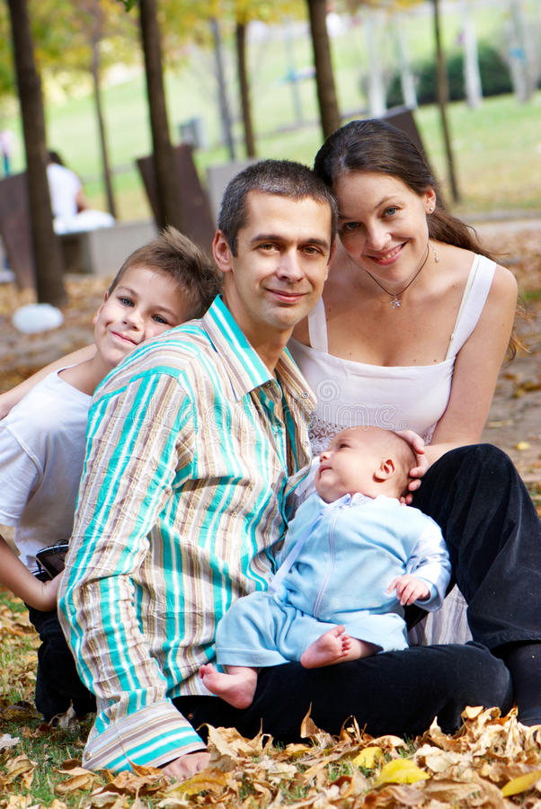 Happy family in autumn park stock images