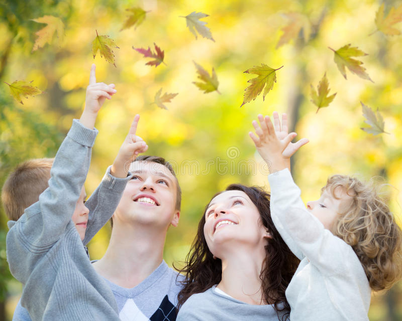 Download Happy Family In Autumn Park Stock Photo - Image of carrying, four: 31470100