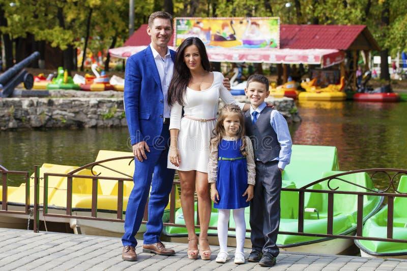 Happy family in autumn park stock image