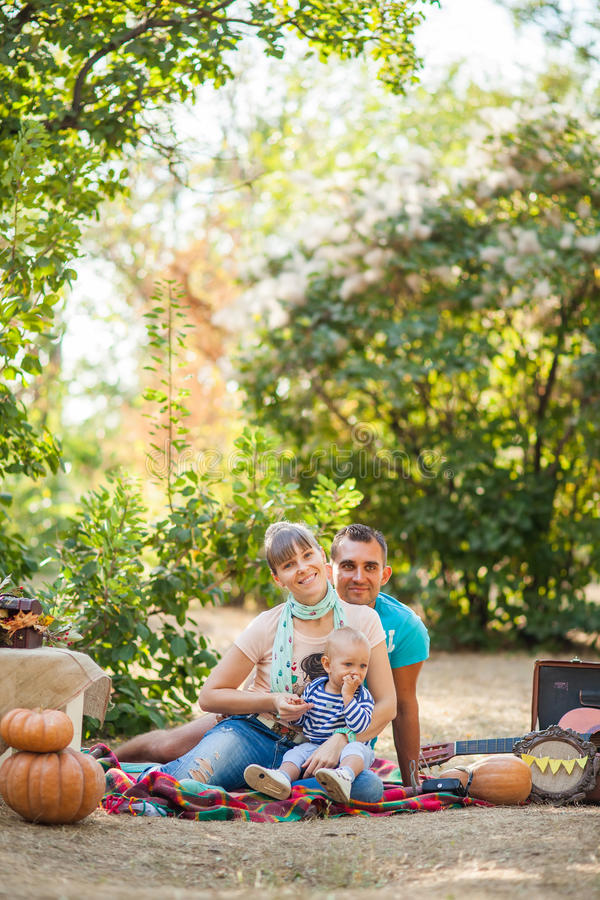 Happy family at autumn picnic stock photography