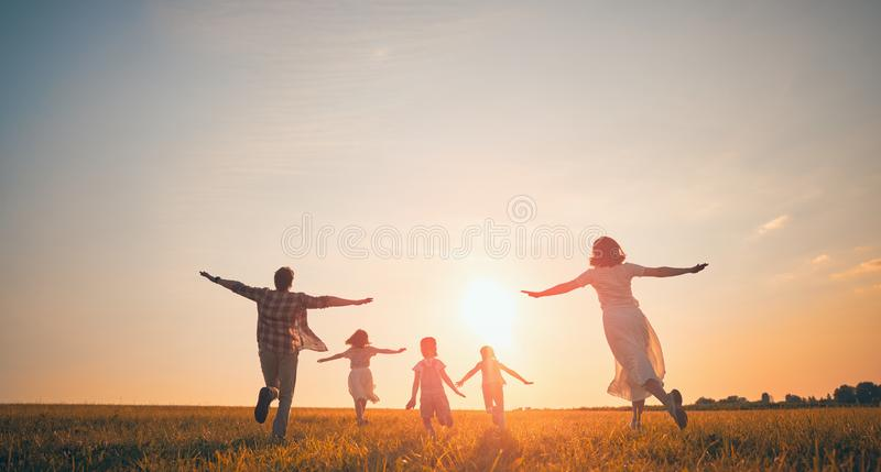 Happy family on autumn walk stock photo