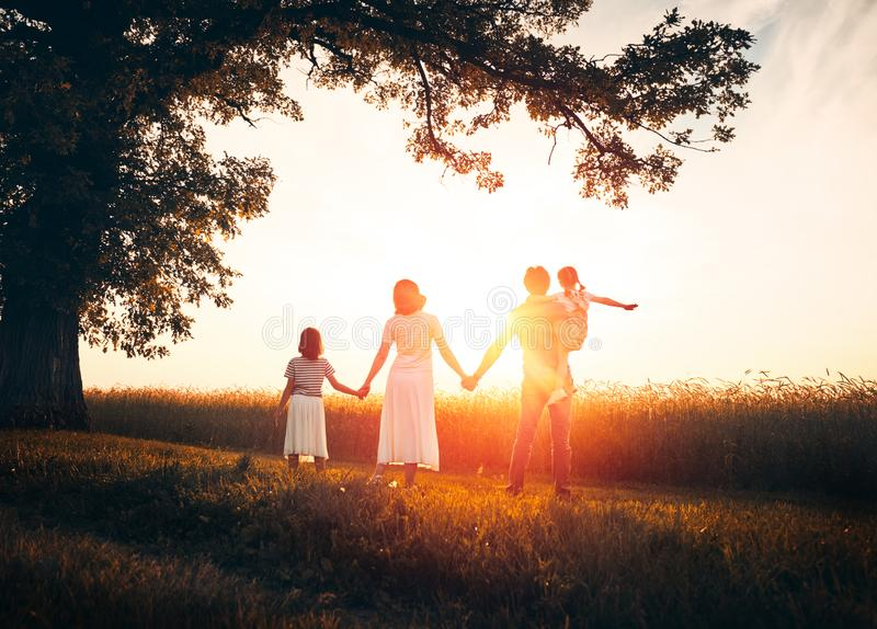 Happy family on autumn walk royalty free stock photography