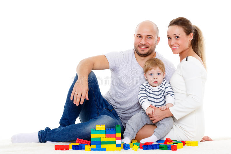 Happy family with baby build house. Happy family with sweet baby build house on a white background. Concept of building and purchase of the house stock image