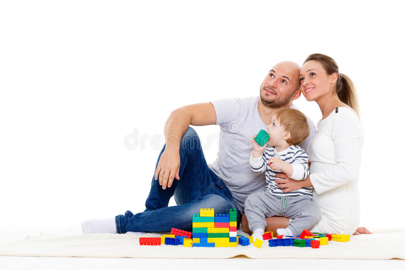 Happy family with baby build house. Happy family with sweet baby build house on a white background. Concept of building and purchase of the house royalty free stock photo