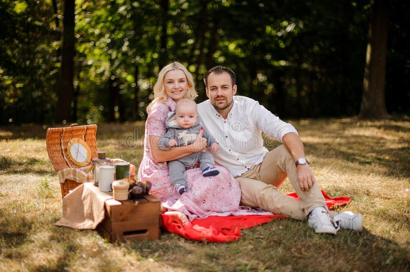 Happy family with baby on the picnic royalty free stock photography