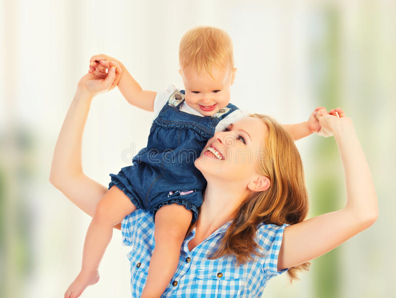 Happy family. baby sits astride the shoulders of the mother stock image