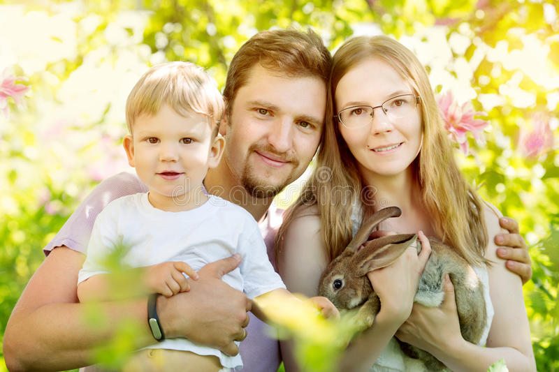 Happy family on a background of the summer landscape. Summer scene about mother, father and son. Summertime party, fun on holiday stock photos
