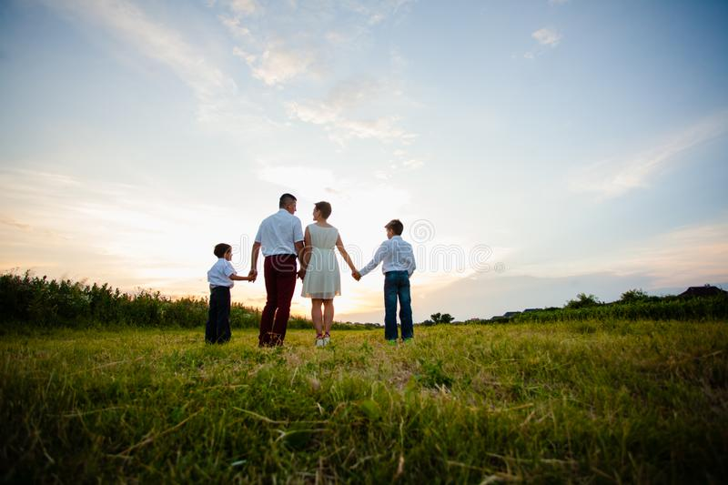 Happy family on the background of the sunset royalty free stock images