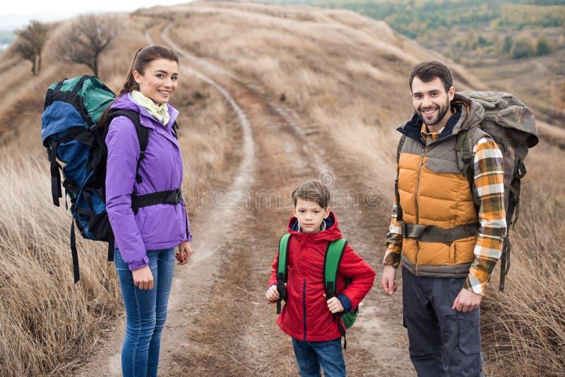 Happy family with backpacks stock photo