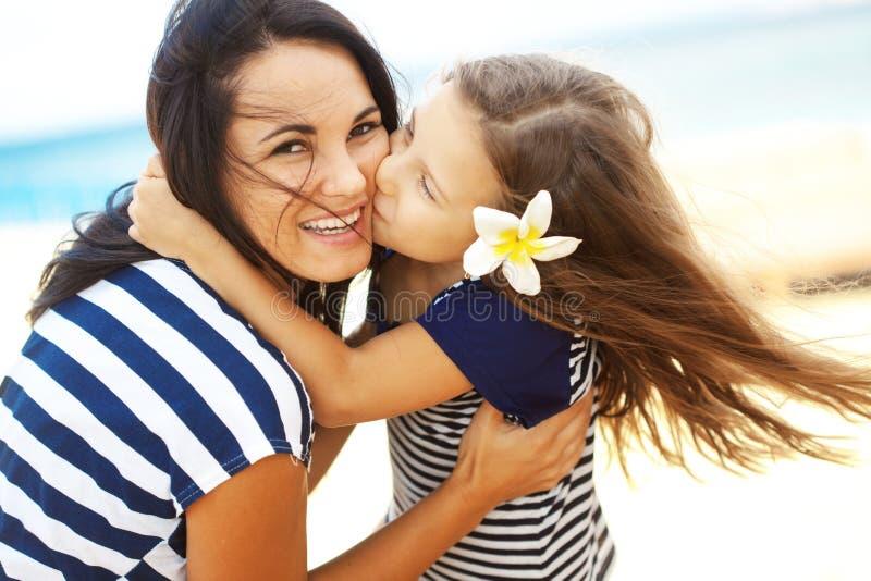 Happy family at beach stock photos