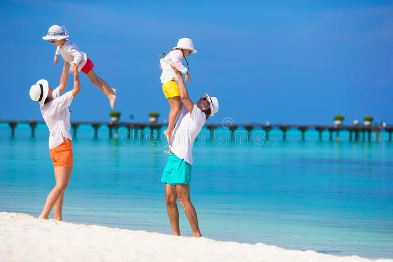 Happy family during beach vacation. Happy beautiful family on a beach during summer vacation stock images