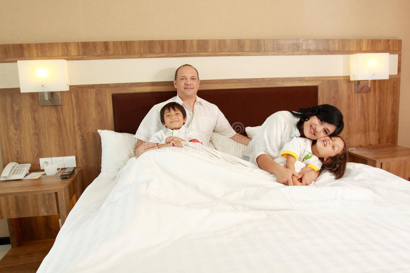 Download Happy family in the bed stock photo. Image of house, family - 25856422