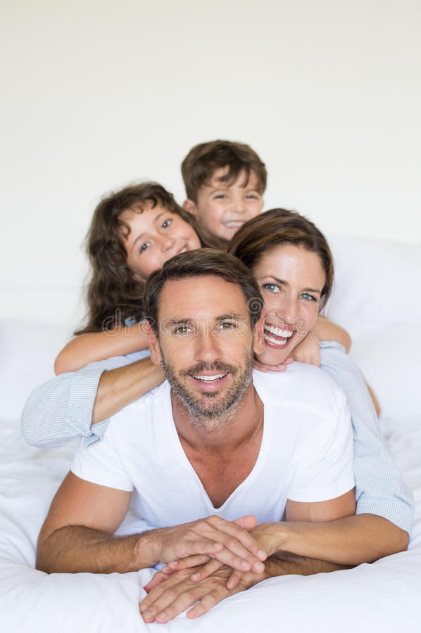 Happy family on bed stock photography