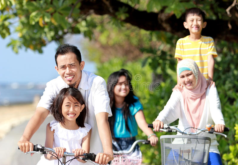Download Happy family with bikes stock photo. Image of family - 26461070