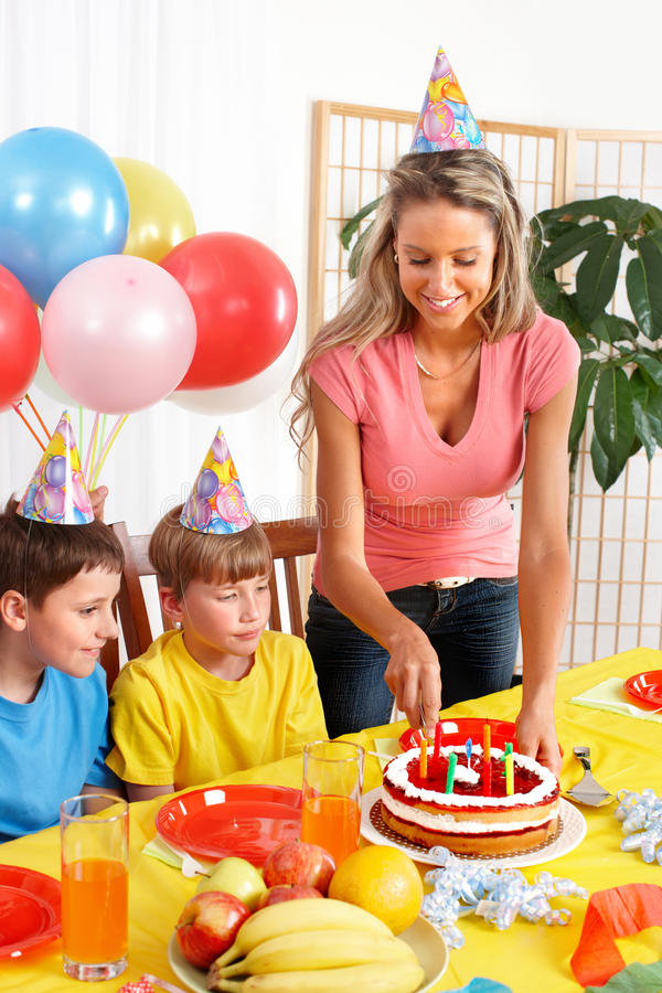 Happy family and birthday. Happy family . Father, mother and children celebrating birthday at home royalty free stock photo