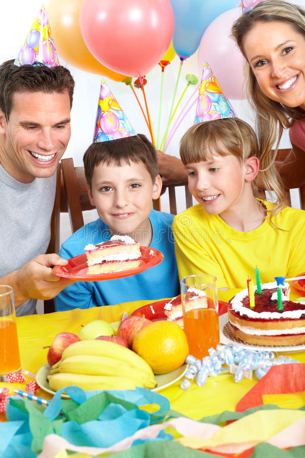 Happy family and birthday. Happy family . Father, mother and children celebrating birthday at home stock image