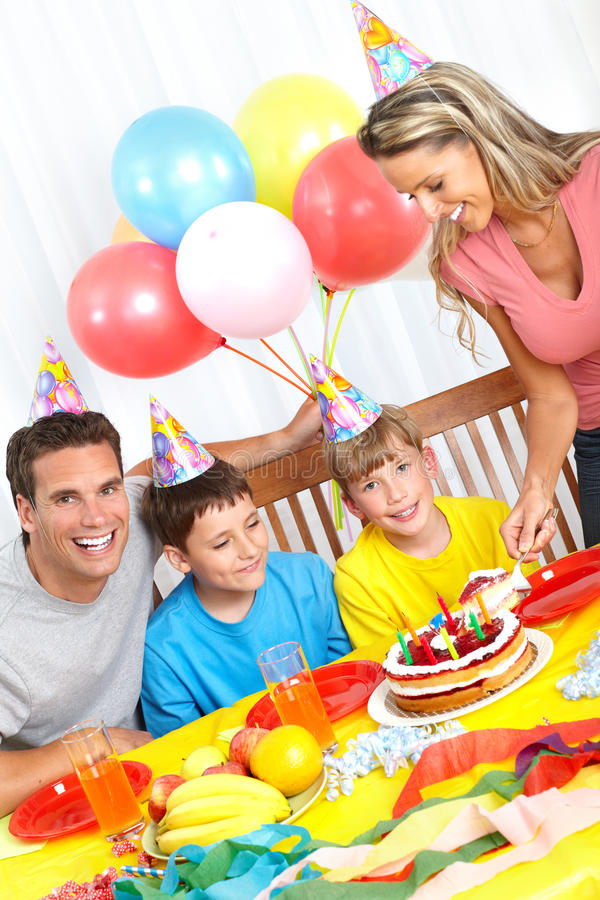 Happy family and birthday. Happy family . Father, mother and children celebrating birthday at home stock photo