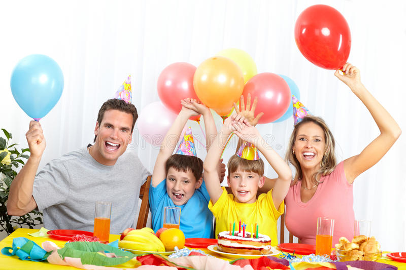 Happy family and birthday. Happy family . Father, mother and children celebrating birthday at home stock photos