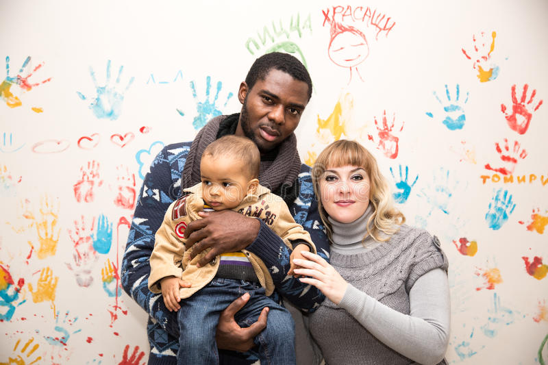 Happy family: black father, mom and baby boy. Use it for a child, parenting. Or love concept stock photography