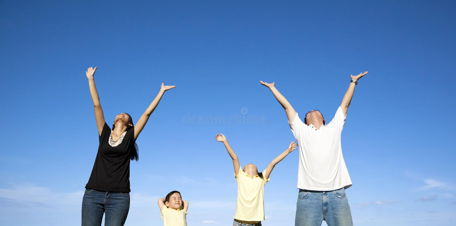 Download Happy family with blue sky stock image. Image of blue - 25002515