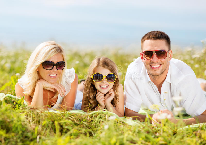 Happy family with blue sky and green grass. Summer holidays, children and people concept - happy family with blue sky and green grass stock photos
