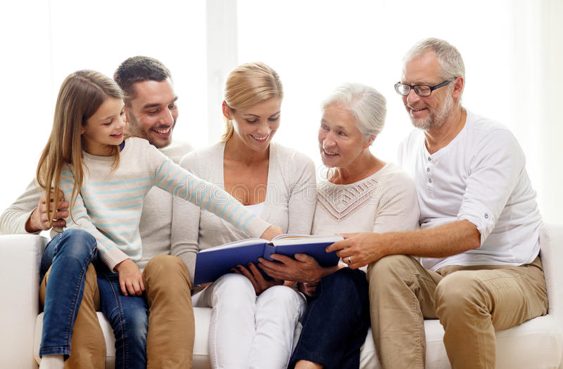 Download Happy Family With Book Or Photo Album At Home Stock Image - Image of grandmother, leisure: 44650169
