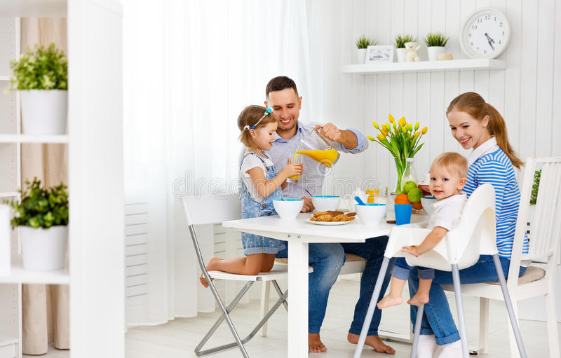 Happy family at breakfast. Happy family mother, father and children at breakfast royalty free stock photos