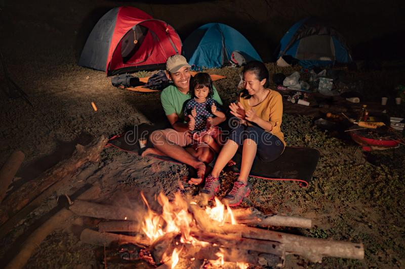 Happy family at camping with campfire royalty free stock photos