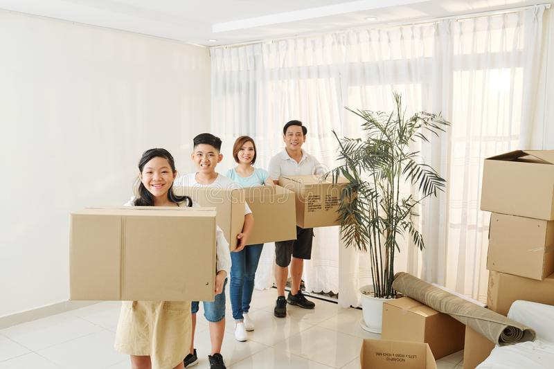 Happy family with cardboard boxes royalty free stock photos