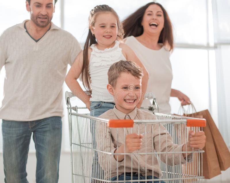 Happy family with cart and kids stock images