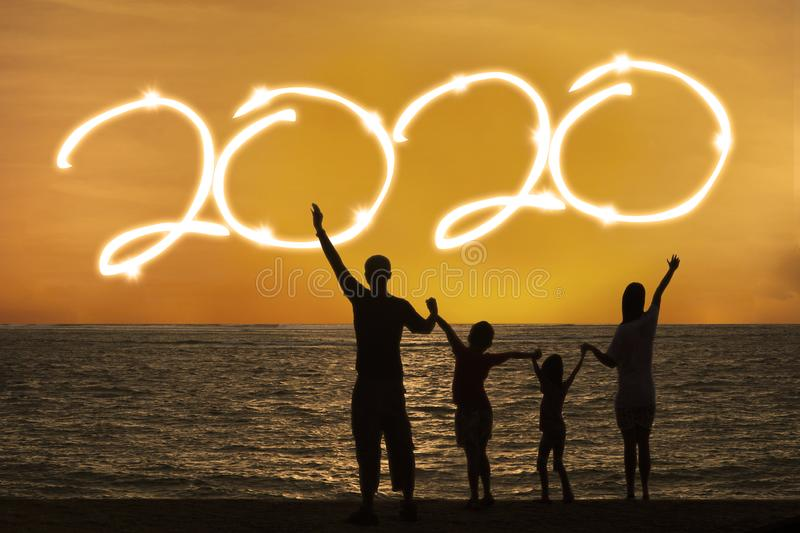 Happy family celebrate new year of 2020 on beach royalty free stock photos