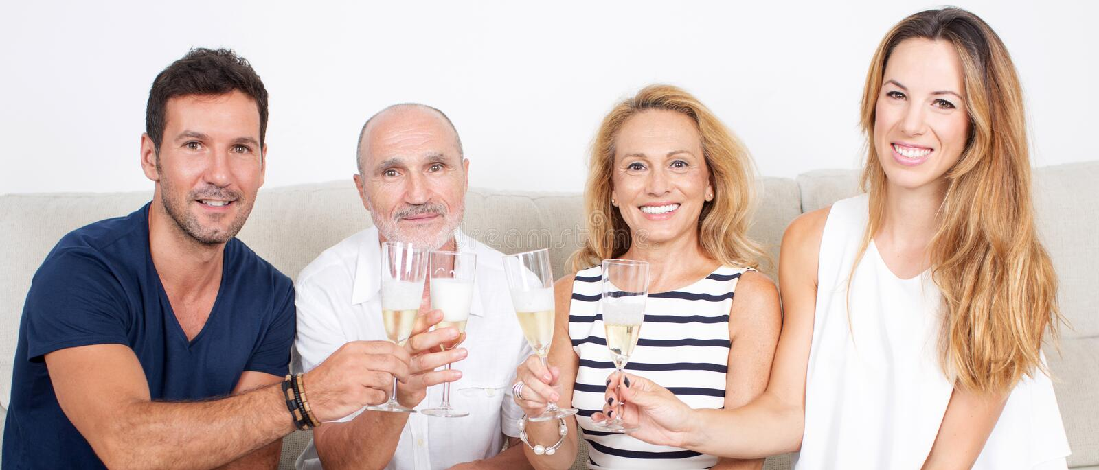 Happy family. Celebrates with champagne royalty free stock images