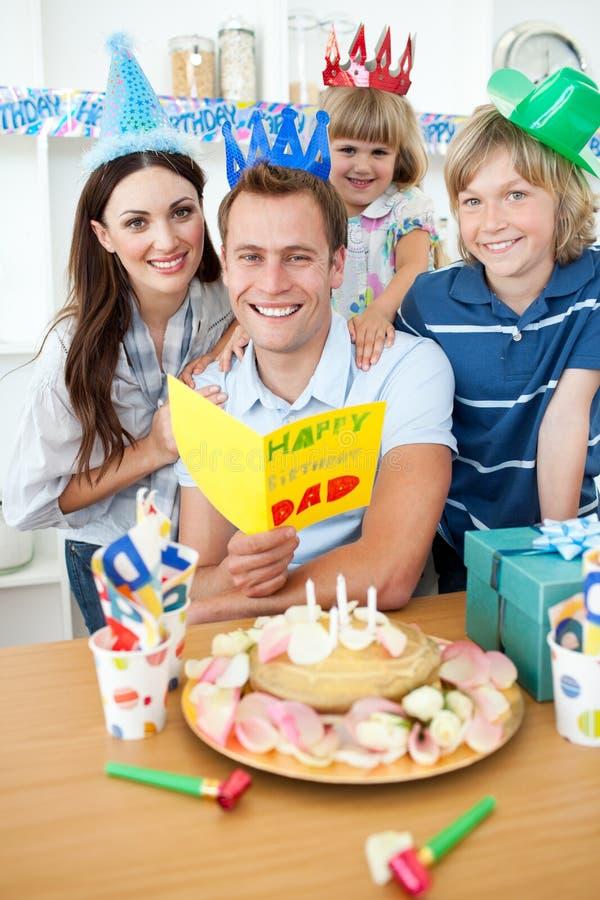 Happy family celebrating birthday. In the kitchen stock photos