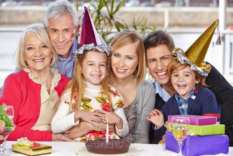 Happy family celebrating birthday. Happy family celebrating child's birthday party together with grandparents royalty free stock photos