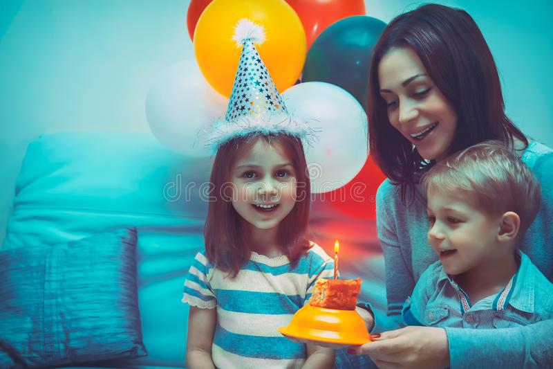 Happy family celebrating birthday royalty free stock photography
