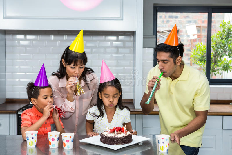 Happy family celebrating a birthday. At home in the kitchen stock photos