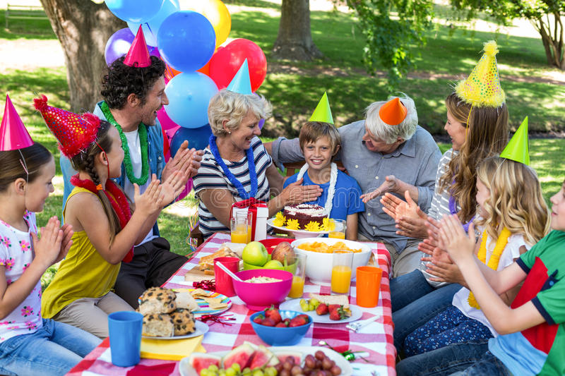 Happy family celebrating a birthday. In the park royalty free stock photography