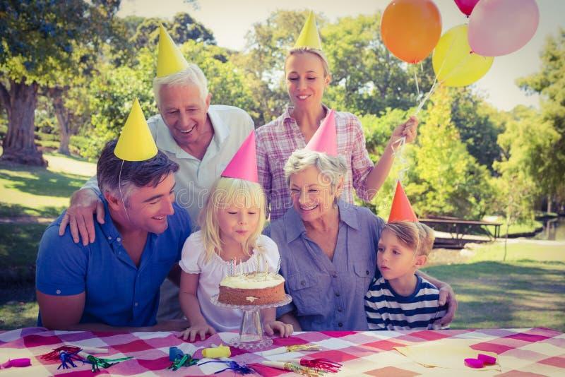 Happy family celebrating a birthday. On a sunny day stock photography