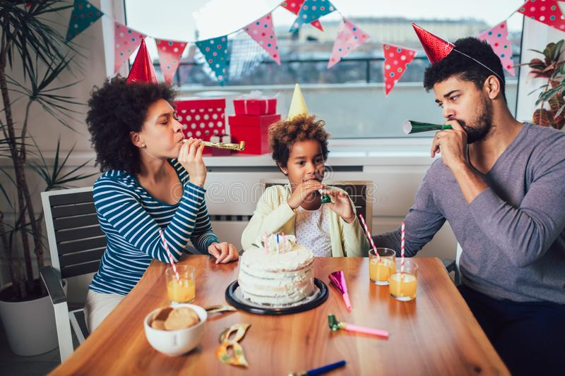 Family celebrating a birthday together at home royalty free stock images