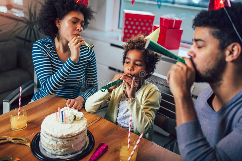 Family celebrating a birthday together at home royalty free stock photography