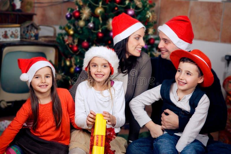 Happy family celebrating Christmas stock photos