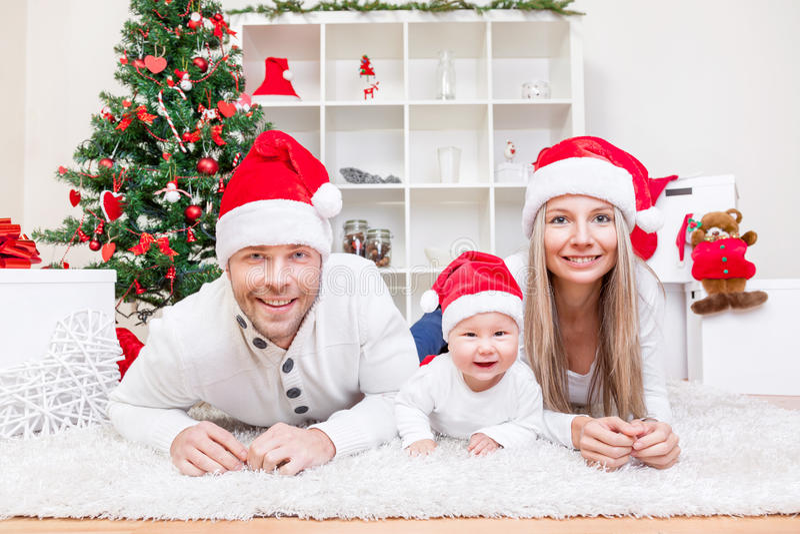 Happy family celebrating Christmas at home stock photos