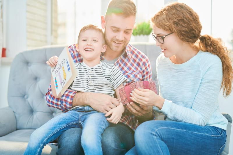 Happy Family Celebrating Fathers Day in Sunlight stock images