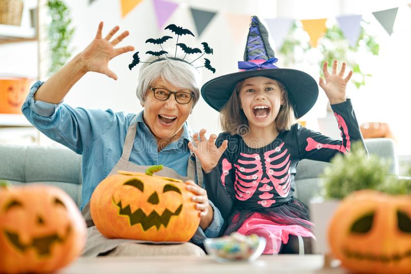 Family celebrating Halloween royalty free stock images