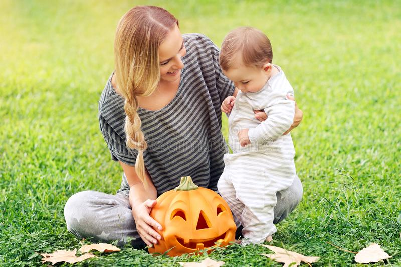Happy family celebrating Halloween stock photos