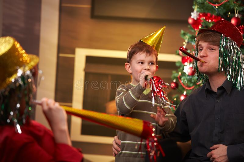 Happy family celebrating new year's eve together stock photos